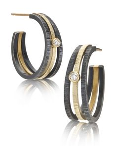 Gold and Silver Hoops with Diamond by Giselle Kolb. These earrings are hand fabricated in *oxidized:oxidize* sterling silver, with a band of 18k yellow gold. Each earring is punctuated with a 0.03ct diamond.