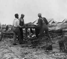 African American men carrying body on stretcher, surrounded by wreckage of the hurricane and flood, Galveston, Texas. Get premium, high resolution news photos at Getty Images 1900 Galveston Hurricane, Texas Hurricane, Galveston Texas, Galveston Island, Hurricane History, Storm Surge, Texas History, Family History, African American Men