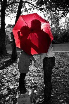 Kiss behind umbrella , standing on a box