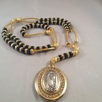 Our Lady of Guadalupe/Pope Rosary Beads Gold and Black plated Contains numerous round size shinny black beads  It also contains 6 round gold color plated beads  It also contains numerous crystal beads  It also contains numerous spagheti style gold color beads Contains a Double side Pendant. ...