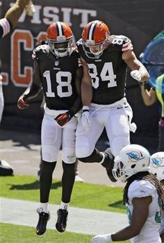 Cleveland Browns wide receiver Greg Little (18) celebrates with tight end Jordan Cameron (84) after Cameron's 7-yard touchdown catch against the Miami Dolphins in the second quarter of an NFL football game Sunday, Sept. 8, 2013, in Cleveland. (AP Photo/Tony Dejak)