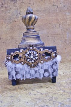 Cute Little Treasure Box, made with cabinet door hardware, finial, vintage pin, feathers, and wine bottle corks for feet