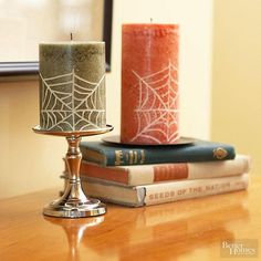 Easily customize ordinary candles for Halloween with a pencil, rubbing alcohol and paint.
