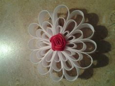 Snow flake bow with red center piece.