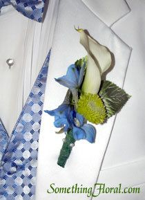 White calla lily groom's boutonniere with blue dephinium and green chrysanthemum. By Something Floral / Something Spectacular, Warren, MI. Photo: Urban Fire Studio #wedding #boutonniere #buttonhole