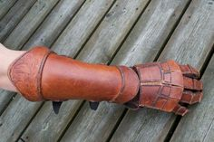 I use these for sword fighting. The Vambrace is decorated in mammen style. The pattern is from a memorial cross from Kirk Braddan, Isle of Man. Leather fighting glove and vambrace 2 Viking Armor, Larp Armor, Cosplay Armor, Leather Bracers, Leather Gloves, Fighting Gloves, Leather Gauntlet, Foam Armor, Viking Costume