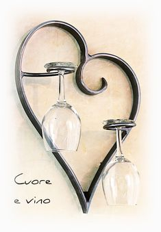 Cuore e Vino (Heart and Wine) Wall Mount Wine or Champagne Glass Rack The Cuore e Vino wine or champagne glass holder is a hand bent iron heart with 2 integrated wine glass holders.  Designed as a simple and decorative way to display your wedding toast glasses or maybe a couple wine glasses from your favorite vineyard.  Handcrafted out of iron in the USA. A great way display for you Champagne Wedding Toasting Flutes Glasses