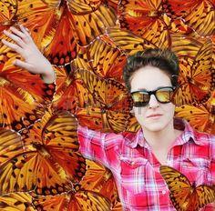 Woman among butterflies