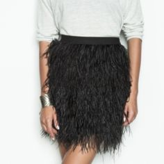 Black Bachata Skirt Never worn but no tags - Ostrich feather skirt with elastic waistband and a side zipper. Fully lined. 95% polyester, 5% spandex. Lining fabric provides stretch, outer layer doesn't stretch. Dry clean or hand wash Pink Martini Skirts Mini