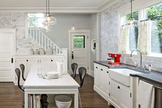 LOVE staircases in kitchens, always wanted a kitchen like this growing up - so classic!!
