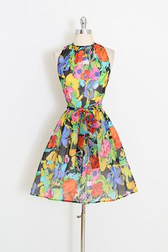 ➳ vintage 1960s dress * black floral crepe * acetate lining * detachable tie belt * back zipper * by Momentum condition   excellent fits like medium length 37 bodice length 16 bust 37-38 waist 28 some clothes may be clipped on dress form to show best fit for appropriate size. ➳ shop http://www.etsy.com/shop/millstreetvintage?ref=si_shop ➳ shop policies http://www.etsy.com/shop/millstreetvintage/policy twitter   MillStVintage facebook   mi...