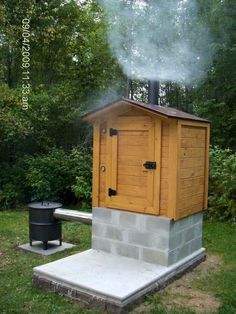 Do you enjoy smoking your meat? I mean, who doesn't love homemade bacon or ham? Everyone should have some type of a smoker and make their own meat creations. It is so tasty! But how do you build a smoker? We show you a selection of awesome smokehouse desi Backyard Projects, Outdoor Projects, Home Projects, Craft Projects, Backyard Ideas, Backyard Parties, Landscaping Ideas, Backyard Landscaping, Garden Ideas