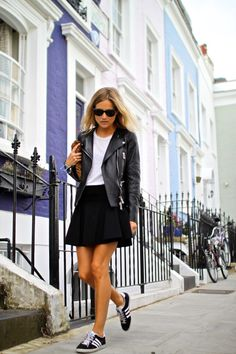 Street style : sneakers, leather jacket, skirt, and a little handbang