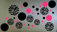 $10.00  These vinyl dots make a great addition to a wall.  There are 33 dots ranging from 1 inch up to 6 inch diameter. We can make different colors upon request.