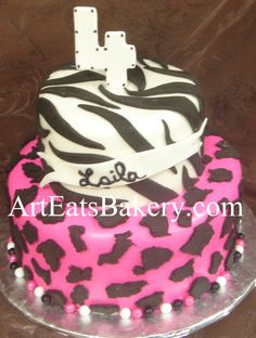 Two tier creative custom girl's animal print black, white and pink zebra and cheeta 4th birthday cake idea picture.jpg (831×1101)