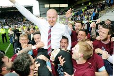 Lancashire Telegraph: Sean Dyche is hoisted aloft by his Burnley players