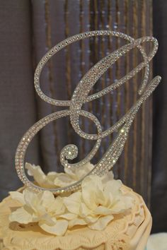 G crystal wedding cake topper. Might be too much bling, but it's pretty!