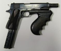 John Dillinger's Colt 1911, chambered for .38 super to pierce body armour, specially modified by gunsmith Hyman Lebman to fire full auto, loaded with an extended magazine, fitted with a Thompson's fore-grip and a Thompson's Cutts compensator.  Holy effing crap.