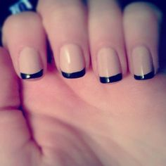 Simplistic French manicure never gets old. Here the nails are coated in matte nude for the base color. The tips are then thinly coated with black polish to finish up the French tip.