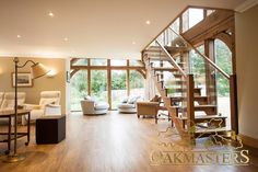 Oak staircase and open plan living area framed by an oak glazed extension.
