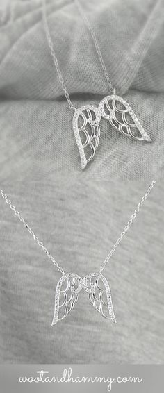 This sparkly angel wings necklace has a see-thru scalloped design.