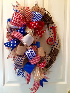 "Ole Miss Rebels SEC Ribbon Grapevine Wreath 18"" Colonel Reb Colors by ItsintheDetailsAMY on Etsy https://www.etsy.com/listing/261385983/ole-miss-rebels-sec-ribbon-grapevine"