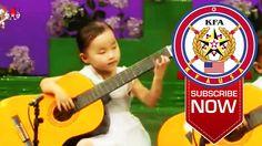 Talented North Korean Children Playing Guitar