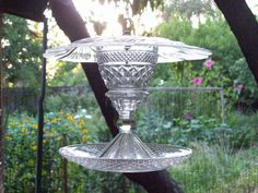 I made this bird feeder using old glassware. So much fun!