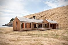 Farmhouse in New Zealand sits just a short walk from the beach. Take a look inside and read more of its owner's unique story here!