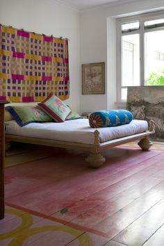 In the master bedroom, Corti painted the floors with her signature decorations and hung an ancient Uzbekistani textile as a headboard   archdigest.com