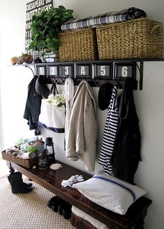 coat rack... I like the idea of separate pieces to create this look & this much storage/functionality. Baskets on the top shelf is a nice touch when additional storage space is at a minimum.