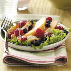 Fruity Chicken Salad with Raspberry Dressing - with berries and melon and a creamy raspberry dressing!