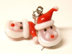 Artisan Handcrafted Santa Claus Lampwork Glass Earrings with Sterling Silver French Style Ear Wires.  Handmade by MelancholyMind on Etsy