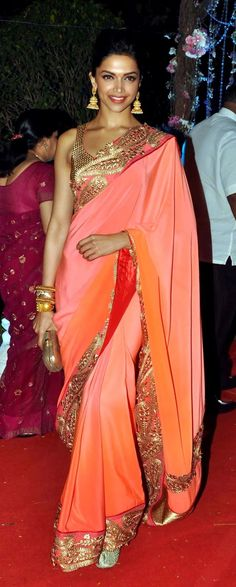 Deepika Padukone in Jade by Monica & Karishma A lovely ombre orange and pink saree with gold embellishments. It's the perfect saree for guests attending an evening wedding function. Beautifully paired with jhumka earrings by Amrapali. Indian designer - Indian couture #thecrimsonbride Sari Hindu, Coral Saree, Peach Saree, Bollywood Wedding, Bollywood Saree, Punjabi Wedding, Bollywood Fashion, Wedding Sari, Wedding Reception