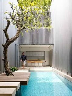 floating pavers of water... love the use of space.  tree is perfect