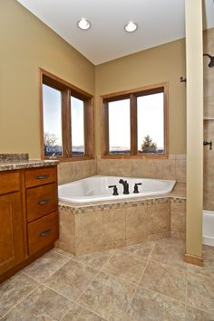 Perfect corner spot for an elegant bathtub, letting the light from the sunset in