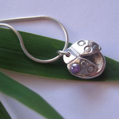 How cute is this!! Ladybird pendant with hidden fingerprint impression underneath! Gorgeous!