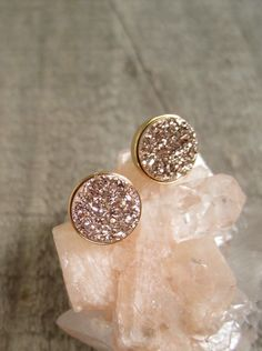 Gorgeous, rose gold colored druzy quartz coins are bezel set in gold vermeil ear posts with backs.