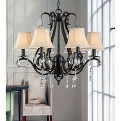 Brighten your home decor with this Black Iron 6-light Crystal Chandelier. This light will add an element of distinction and elegance to your home. This fixture needs to be hard wired. Professional ins