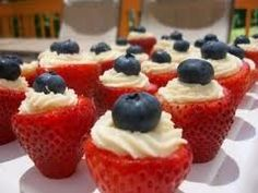 Cute strawberries.  Filled with cream and topped with a blueberry.  Easy party food