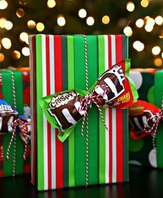 Ideas - 2017 Holiday Gift Guide More Unique Gift Ideas and a fun way to gift wrap not just for the Christmas goliday season but any theme any time. Adding a special candy treat to your packaging - such as this M&Ms bow. Birthday Gift Wrapping, Birthday Candy, Christmas Gift Wrapping, Funny Birthday, Birthday Presents, Gift Wrapping Ideas For Birthdays, Birthday Woman, Birthday Gifts For Man, Gift For Man