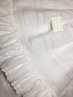 Traditional French Handsewn Christening Gown with Matching Slip & Bonnet Size: Infant GOWN DETAIL This traditional-style French Handsewn Gown features a complete round yoke (cut from a lace block with no shoulder seams) made of French Lace Insertion, French Lace Beading, Entredeux
