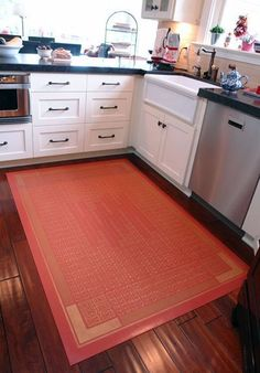Great idea if you need to cover your kitchen floor to either protect it or hide its blemishes. Floor cloths are harder than carpet but still rug-like in form. Great way to add color!