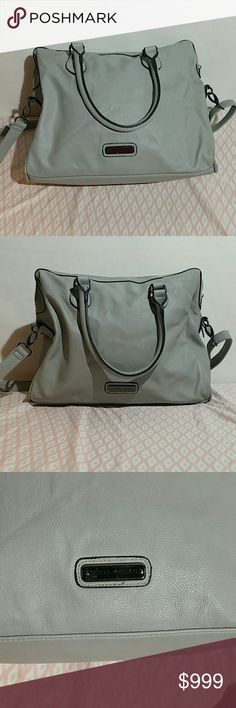 Steve Madden purse with removable shoulder strap Gray Steve Madden purse. There is some discoloration on the inside and flaws on the purse, including a line of pink ink as shown.. This is in decent used condition. Please look at the photos closely to judge condition for yourself. Steve Madden Bags Satchels