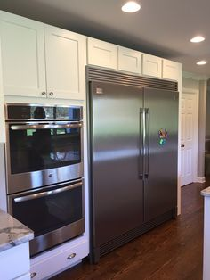 My new kitchen. Frigidaire twins with double trim kit. Medallion white icing cabinets, Central Park west door style. GE double ovens with double probes.
