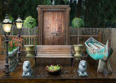Great vignette using old door..  eclectic patio by Elad Gonen & Zeev Beech