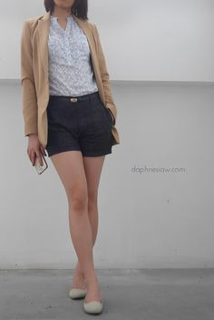 Smart casual women's outfit for the summer. Blouse, high waist shorts and coat…