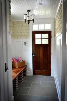 Bringing some of the materials and colors from the exterior into the vestibule blurs the lines between inside and out.