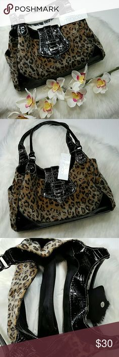 Leopard print bag Black and brown Leopard print bag.  Two open pockets on both ends, two big compartments in the middle, fold over snap closure.  Leopard print material has a fur feel. Excellent condition.  14 L, 5 1/2 W, 9 H. Handles are 19 in. minicci Bags Shoulder Bags