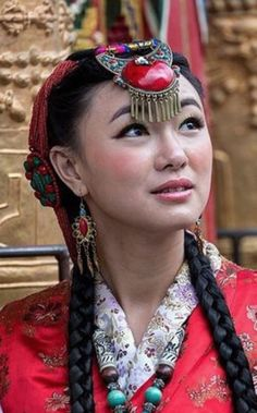 Tibetan brides typically wear white, though more visible is what's layered on top, including colorful jackets, scarves and jewelry like beaded necklaces and headdresses.